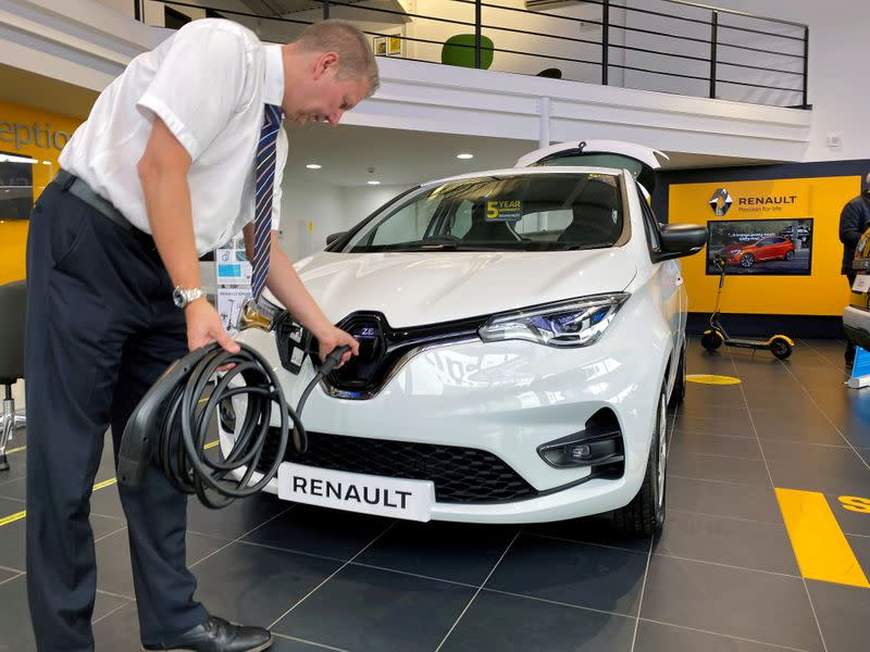 FILE PHOTO: Steve Tomlin shows the new version of Renault's small battery electric Zoe model car in Reading, Britain