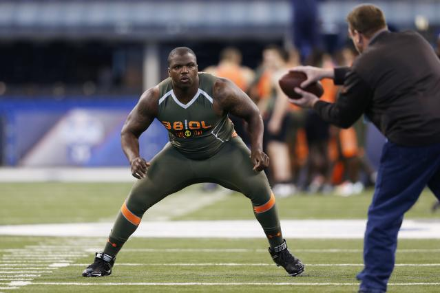 INDIANAPOLIS, IN - FEBRUARY 22: Former Auburn offensive lineman Greg Robinson takes part in a drill during the 2014 NFL Combine at Lucas Oil Stadium on February 22, 2014 in Indianapolis, Indiana. (Photo by Joe Robbins/Getty Images)