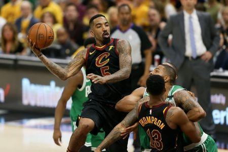 May 19, 2018; Cleveland, OH, USA; Cleveland Cavaliers guard JR Smith (5) looks to pass against the Boston Celtics during the second quarter in game three of the Eastern conference finals of the 2018 NBA Playoffs at Quicken Loans Arena. Mandatory Credit: Aaron Doster-USA TODAY Sports