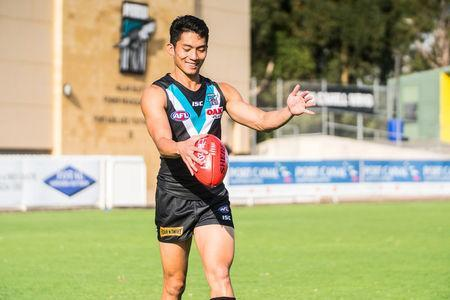 Port Adelaide Australian Rules football club's international academy recruit Chen Shaoliang from China prepares to kick a ball in Adelaide, Australia, March 21, 2017. Port Adelaide Football Club/Handout via REUTERS.