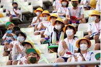<p>Young fans wearing face masks enjoy the pre match atmosphere prior to the Men's First Round Group B match between New Zealand and Honduras on day two of the Tokyo 2020 Olympic Games at Ibaraki Kashima Stadium on July 25, 2021 in Kashima, Ibaraki, Japan. (Photo by Atsushi Tomura/Getty Images)</p>
