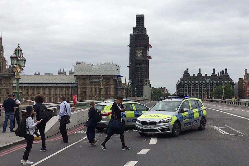 Police officers cordon off Westminster Bridge, leading to Parliament Square, after Salih Khater rammed his car into barriers at the Houses of Parliament on August 14, 2018 (AFP/Getty Images)
