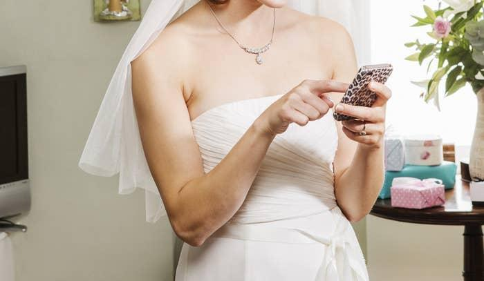 A bride texting on her phone