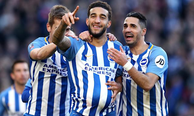Connor Goldson celebrates scoring Brighton's second goal against Coventry with Beram Kayal.