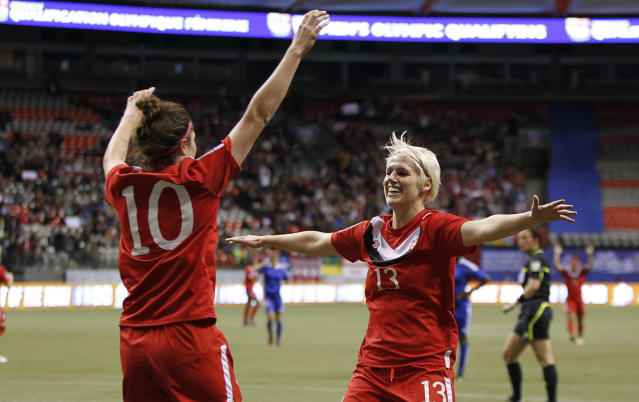 VANCOUVER, CANADA - JANUARY 19: Goal scorer Christina Julien #10 of Canada is congratulated by Sophie Schmidt #13 after scoring against Haiti during the 2012 CONCACAF Women's Olympic Qualifying Tournament at BC Place on January 19, 2012 in Vancouver, British Columbia, Canada. (Photo by Jeff Vinnick/Getty Images)