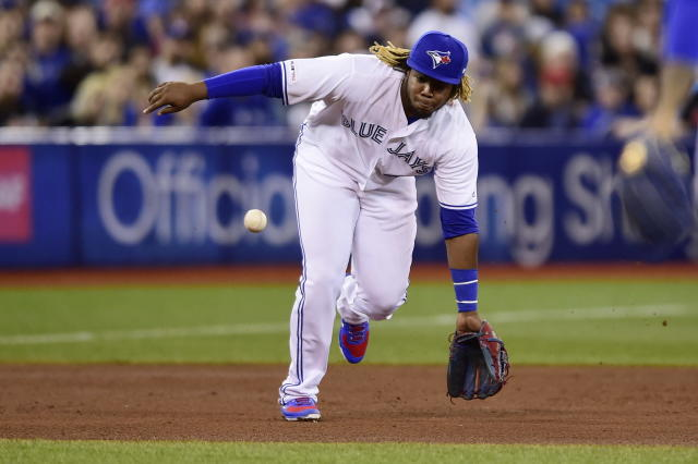 Toronto Blue Jays third baseman Vladimir Guerrero Jr. makes the catch before throwing to first to put out Oakland Athletics' Stephen Piscotty during fourth-inning baseball game action in Toronto, Friday, April 26, 2019. (Frank Gunn/The Canadian Press via AP)