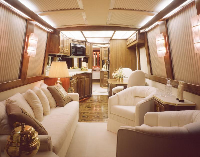 This image is a 40' luxury bus motor home interior view looking from the front to rear.