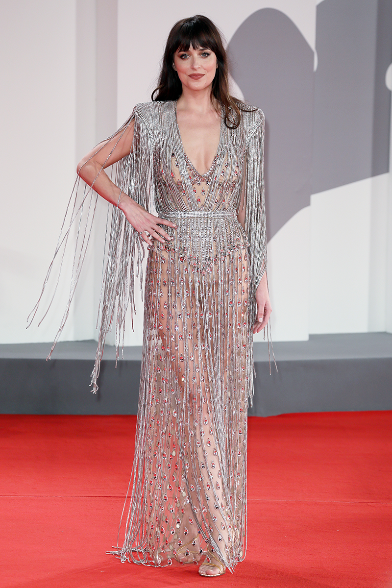 <p>Dakota Johnson looks approx one zillion bucks in this metallic fringed Gucci naked dress at The Lost Daughter screening.</p>