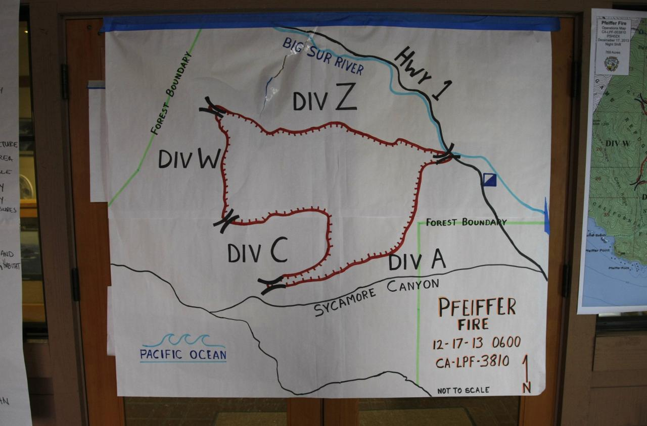 A map of the Pfeiffer Fire is displayed at the Ranger Station in Big Sur, California, December 17, 2013. Crews battling the wildfire along central California's scenic Big Sur coastline were on guard against a possible shift in winds on Tuesday, after the blaze destroyed at least 15 dwellings and forced 100 people to flee their homes, fire and county officials said. REUTERS/Michael Fiala (UNITED STATES - Tags: ENVIRONMENT DISASTER)