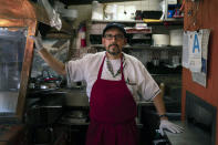 """Edward Flores, 56, a fourth-generation owner of Juanita's Cafe on Olvera Street, stands for a photo in his restaurant in Los Angeles, Friday, June 4, 2021. Flores said he has gone deep into debt keeping Juanita's Café, a small food stand in his family for three generations, open. Business is down more than 87%, he said. In April, his best month during the pandemic, he had $3,100 in sales, but that pales in comparison to his rent of $3,625 — even though it was forgiven — not to mention utilities, insurance and property tax. On his worst day of the pandemic, he worked alone for 13 hours and recorded sales of $11.25. """"I didn't have a doomsday thought. I just was just flabbergasted,"""" he said. """"I thought what an incredible waste of time."""" (AP Photo/Jae C. Hong)"""