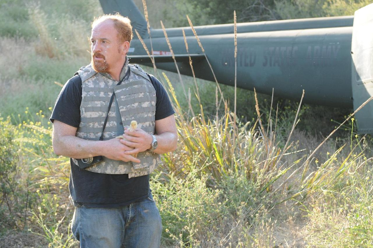 "This undated image released by FX shows Louis C.K. in a scene from ""Louie."" Louis C.K. was nominated for an Emmy award Thursday, July 19, 2012 for outstanding lead actor in a comedy series. The 64th annual Primetime Emmy Awards will be presented Sept. 23 at the Nokia Theatre in Los Angeles, hosted by Jimmy Kimmel and airing live on ABC. (AP Photo/FX)"