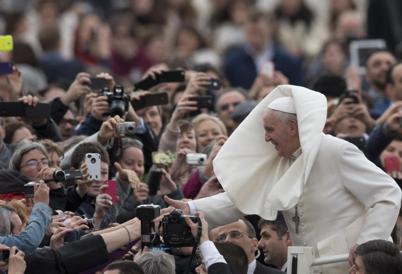 Pope Francis is greeted by the faithful as he tours St. Peter's Square at the Vatican, prior to his general audience, Wednesday, Feb. 19, 2014. (AP Photo/Alessandra Tarantino)