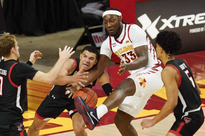 Texas Tech guard Kevin McCullar fights for a rebound with Iowa State forward Solomon Young (33) during the first half of an NCAA college basketball game, Saturday, Jan. 9, 2021, in Ames, Iowa. (AP Photo/Charlie Neibergall)
