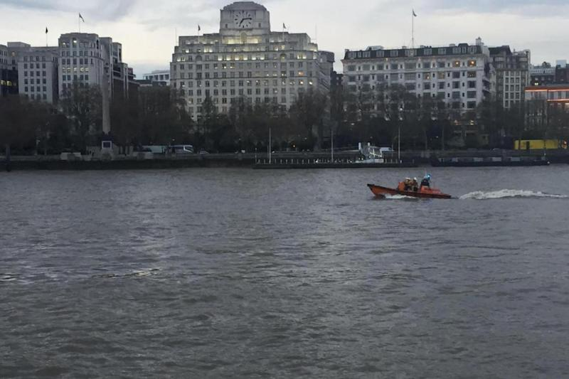 Rescue mission: RNLI crews search for the man in the Thames (Chris Baynes)