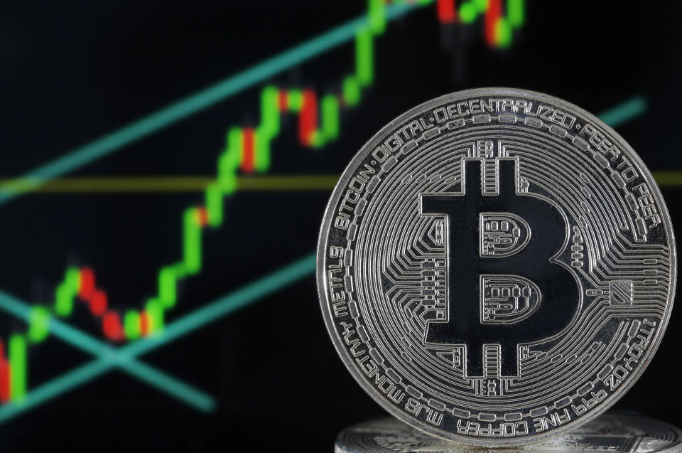 PARIS, FRANCE - JUNE 25: In this photo illustration, a visual representation of the digital Cryptocurrency, Bitcoin is displayed in front of the Bitcoin course's graph on June 25, 2019 in Paris, France. Bitcoin surpassed the 11,000 dollar mark Monday, Facebook's arrival on the cryptocurrency market with Libra has boosted global interest around the various currencies in circulation. Bitcoin has reached its highest level since March 5, 2018.(Photo by Chesnot/Getty Images)