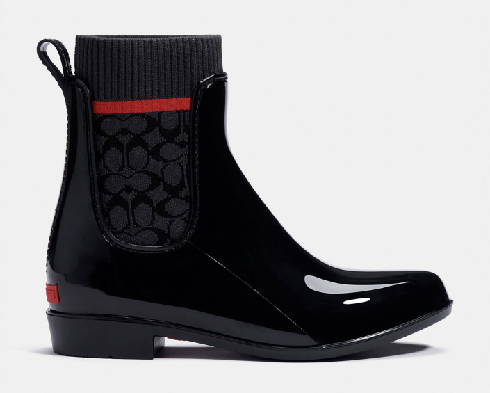 glossy black Coach Rain Booties with red stripe sock