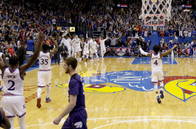 Kansas celebrates after Barry Brown Jr. misses the game-winning shot for Kansas State in Allen Fieldhouse. (AP Photo)