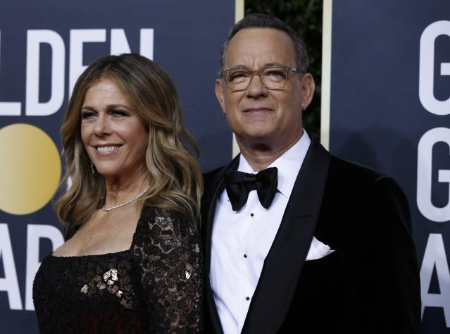 Tom Hanks and Rita Wilson, who both tested positive for the coronavirus, are making the most of their time in quarantine by playing cards. (Photo: Reuters)