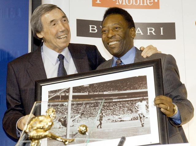 Former International soccer players England goal keeper, Gordon Banks (left) with a picture of his famous save from Brazil striker Pele (right).