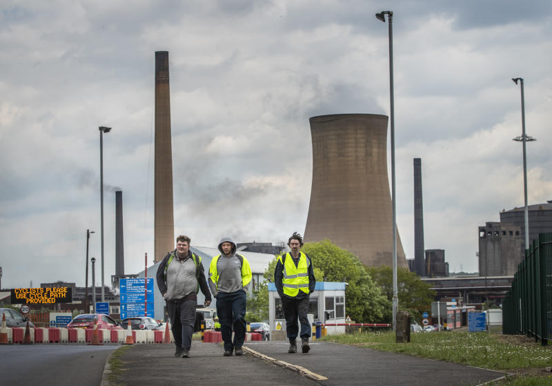 Workers leave the steelworks plant in Scunthorpe following a shift change as owner British Steel is to go into official recievership after failing to secure funds for its future