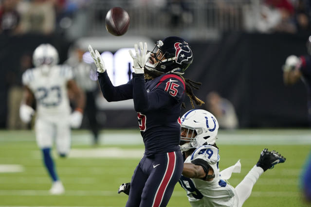 Houston Texans wide receiver Will Fuller (15) makes a catch over Indianapolis Colts cornerback Marvell Tell (39) during the second half of an NFL football game Thursday, Nov. 21, 2019, in Houston. (AP Photo/David J. Phillip)