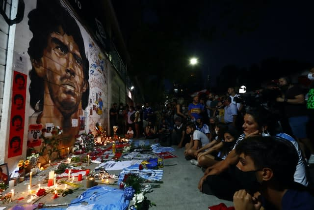Fans hold a vigil for Diego Maradona outside the stadium of Argentinos Juniors