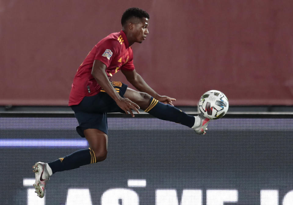 Spain's Ansu Fati is airborne as he attempts to control the ball during the UEFA Nations League soccer match between Spain and Ukraine at the Estadio Alfredo Di Stefano stadium in Madrid, Spain, Sunday, Sept. 6, 2020. (AP Photo/Bernat Armangue)