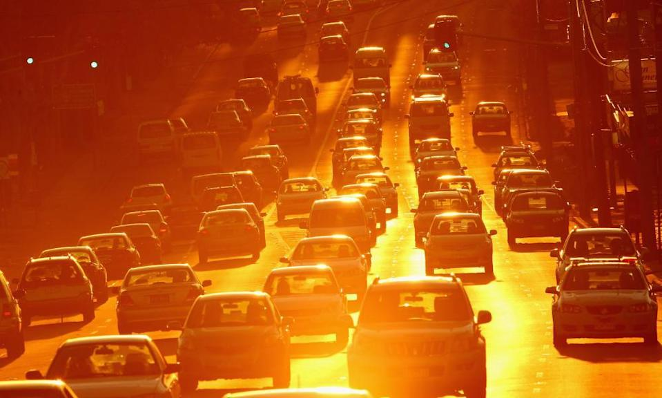 Rush hour traffic on a congested road as the sun sets in Melbourne