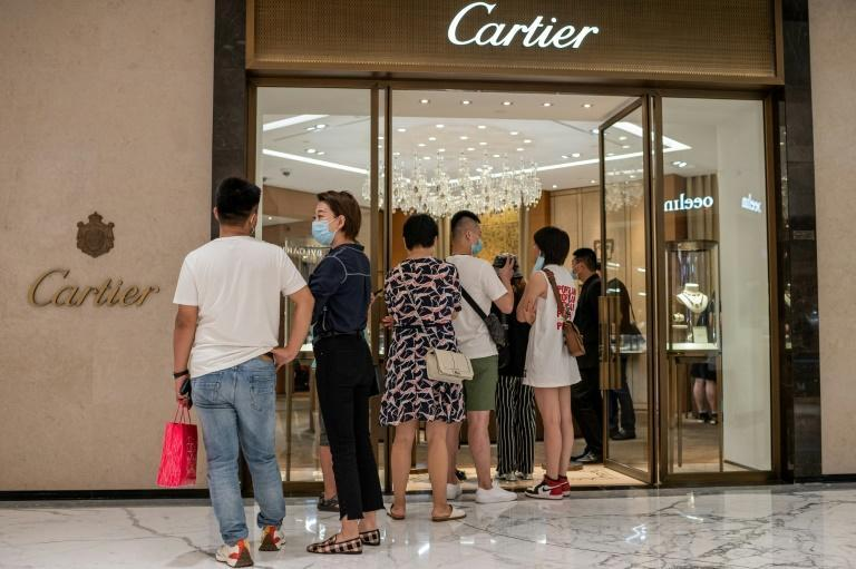 Plenty of people waiting to get into Cartier's store in Beijing in August -- as international tourism was choked off Chinese spent more on luxury items at home