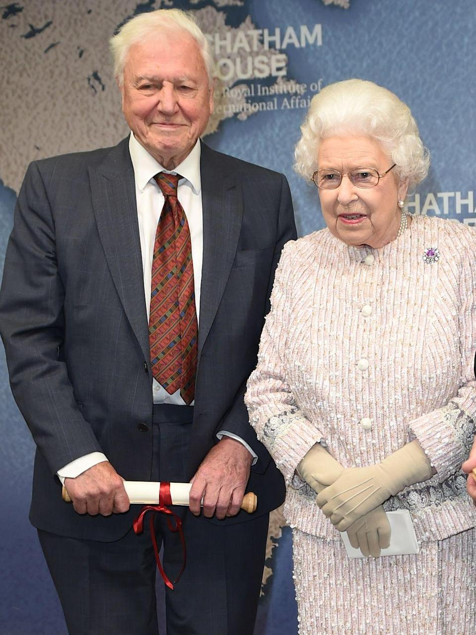 """<p>On the same day that her son Prince Andrew stepped back from public duties in the wake of his interview about his relationship with Jeffrey Epstein, <a href=""""https://www.townandcountrymag.com/society/tradition/a26990236/david-attenborough-queen-elizabeth-prince-william-royal-family-friend/"""" rel=""""nofollow noopener"""" target=""""_blank"""" data-ylk=""""slk:the Queen presented an award to David Attenborough."""" class=""""link rapid-noclick-resp"""">the Queen presented an award to David Attenborough. </a></p>"""