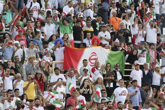 Iranian fans celebrate end of the AFC Asian Cup group D soccer match between Iran and Vietnam at Al Nahyan Stadium in Abu Dhabi, United Arab Emirates, Saturday, Jan. 12, 2019. Iran won 2-0. (AP Photo/Kamran Jebreili)