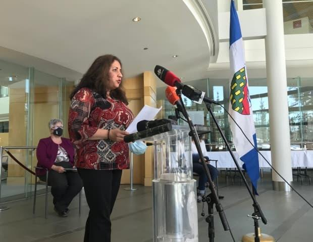 Dr. Kami Kandola, the N.W.T.'s chief medical officer of health, addresses reporters in the legislative assembly on Monday, following an announcement of a COVID-19 outbreak at Yellowknife's N.J. Macpherson School.