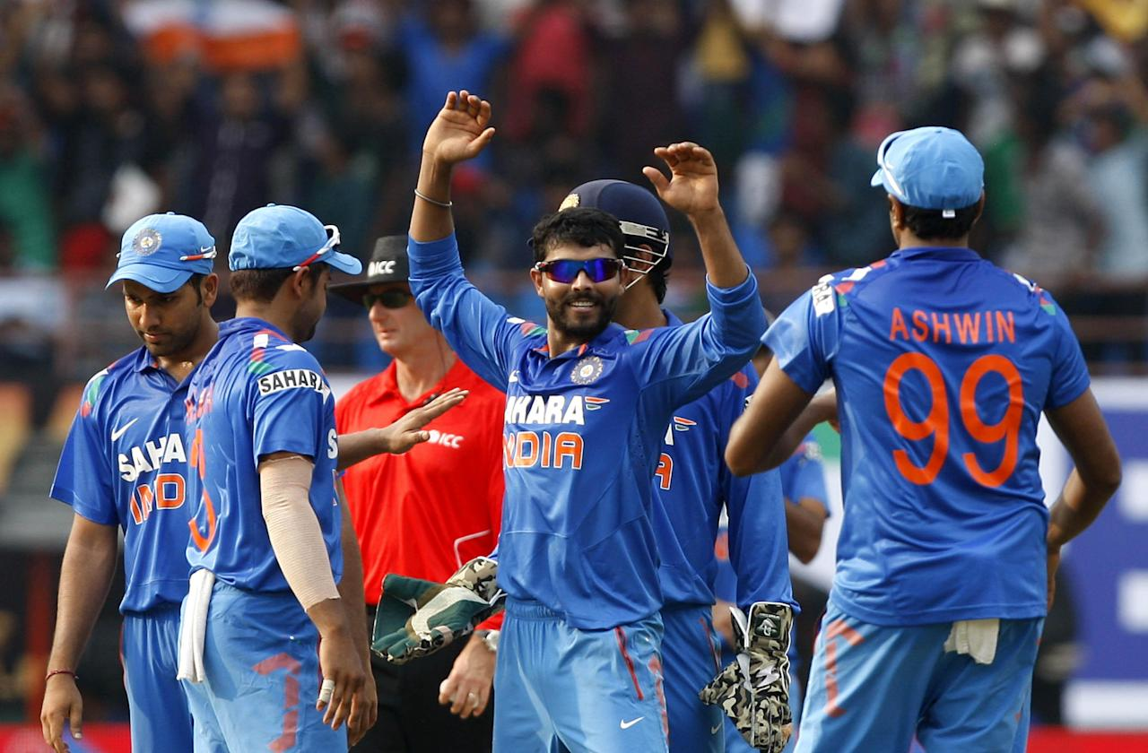 Indian players celebrate after fall of a during the 1st ODI match between India and West Indies at Nehru Stadium in Kochi on Nov.21, 2013. (Photo: IANS)