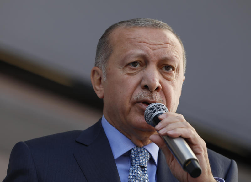 """In this Thursday, March 14, 2019 photo, Turkey's President Recep Tayyip Erdogan addresses the supporters of his ruling Justice and Development Party, AKP, during a rally in Ankara, Turkey. Erdogan has condemned the attacks on mosques in the New Zealand city of Christchurch calling it the """"latest example of rising racism and Islamophobia."""" (AP Photo/Burhan Ozbilici)"""