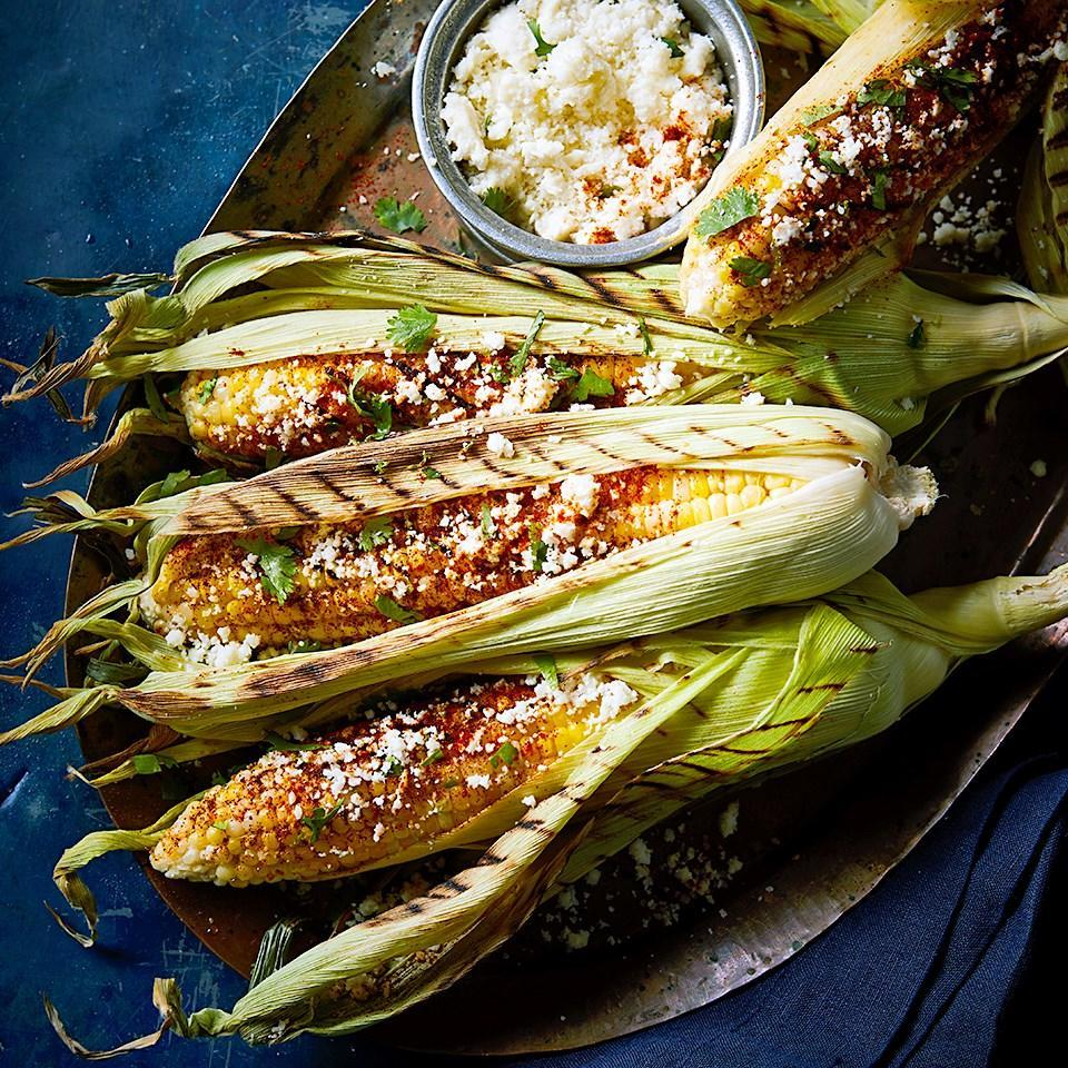 <p>Soaking the corn in its husk in water for up to two hours before grilling is definitely a new approach to cooking corn on the cob, but give it a try! The addition of salt, spices and cheese takes this side dish to new levels.</p>