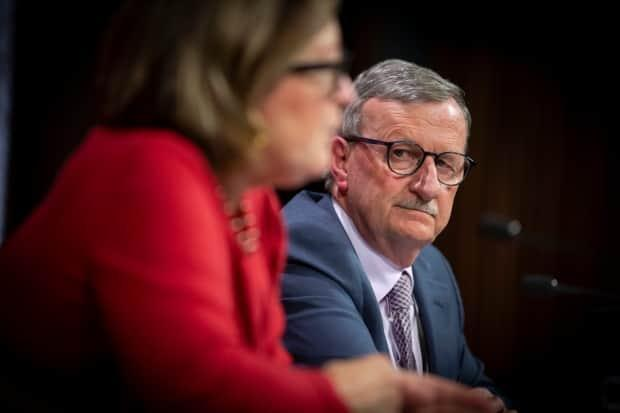 Dr. David Williams, right, appears at a news conference with Dr. Barbara Yaffe, Ontario's associate chief medical officer of health. Williams will be replaced as chief medical officer of health in June. (Evan Mitsui/CBC - image credit)