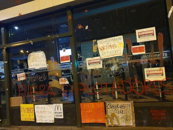 PHOTO: Protest signs are seen outside of a closed McDonald's restaurant, in Miraflores near Lima, Peru, Dec. 17, 2019. (Gisselle Alvarez Meza via Reuters)