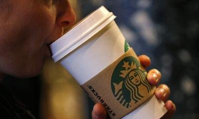Starbucks trials 5p paper cup charge to help reduce plastic waste