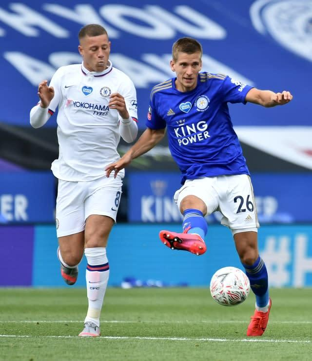Ross Barkley (left) battles for the ball with Leicester's Dennis Praet in the FA Cup quarter-final tie at the King Power Stadium.