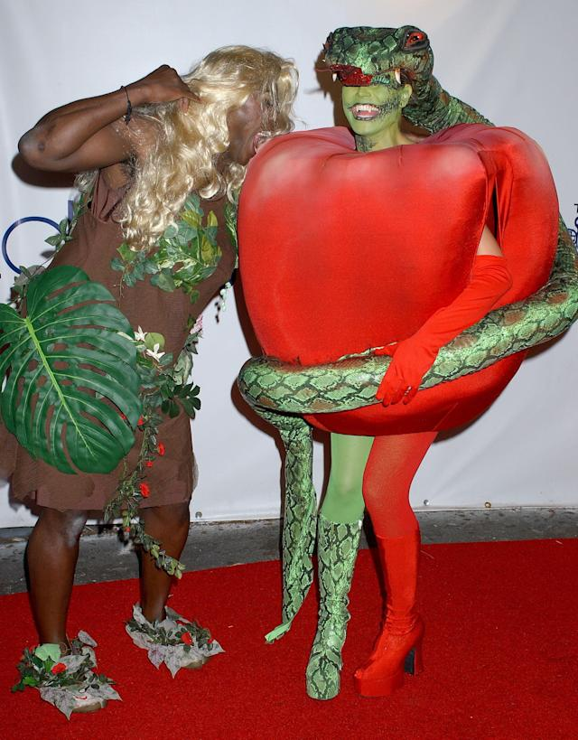 <p>Klum is the unofficial queen of the Halloween, so when she was married to Seal, they both wore elaborate costumes. One year they depicted a scene from the Garden of Eden. (Photo: Getty Images) </p>