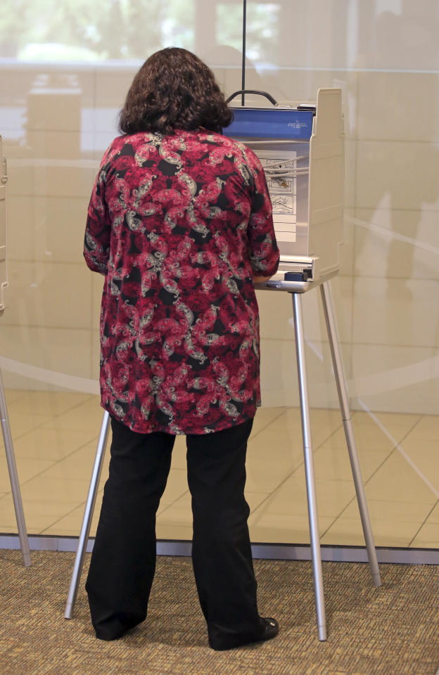 Annabelle Davis, of Provo, casts her vote Tuesday, Aug. 15, 2017, in Provo, Utah. The winner of a three-way Republican primary Tuesday, Aug. 15, 2017, in Utah will become the favorite to win the November special election and fill the congressional seat recently vacated by Jason Chaffetz. Republicans outnumber Democrats five-to-one in Utah's 3rd Congressional District, which stretches from the Salt Lake City suburbs and several ski towns southeast to Provo and Utah coal country. (AP Photo/Rick Bowmer)