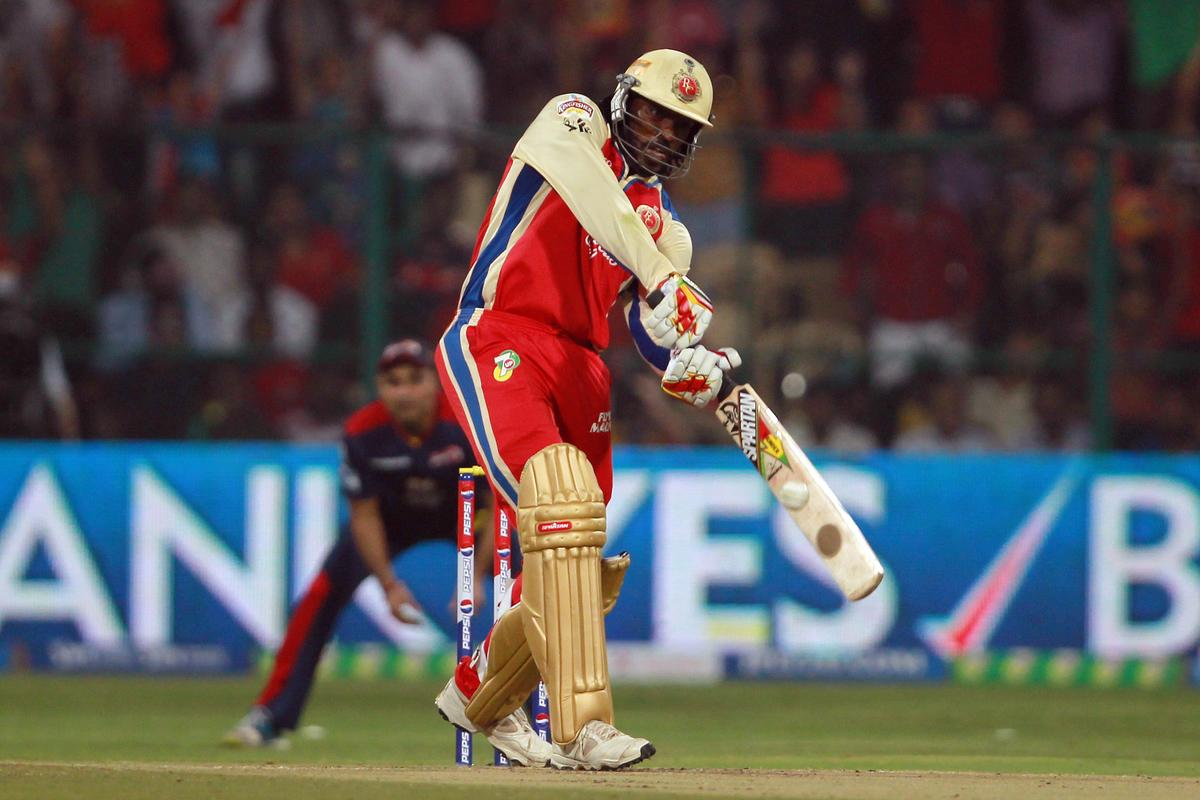 Chris Gayle hits the first six of the innings during match 21 of the Pepsi Indian Premier League between The Royal Challengers Bangalore and The Delhi Daredevils held at the M. Chinnaswamy Stadium, Bengaluru  on the 16th April 2013. Photo by Jacques Rossouw-IPL-SPORTZPICS ...Use of this image is subject to the terms and conditions as outlined by the BCCI. These terms can be found by following this link:..https://ec.yimg.com/ec?url=http%3a%2f%2fwww.sportzpics.co.za%2fimage%2fI0000SoRagM2cIEc&t=1493388570&sig=5QUmtL6kO_Kp1IbZmNnE.g--~C