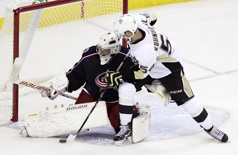 Columbus Blue Jackets' Oscar Dansk, left, of Sweden, makes a save against Pittsburgh Penguins' Tom Kuhnhacki, of Germany, during the third period of an NHL preseason hockey game, Sunday, Sept. 15, 2013, in Columbus, Ohio. The Blue Jackets beat the Penguins 5-4. (AP Photo/Jay LaPrete)