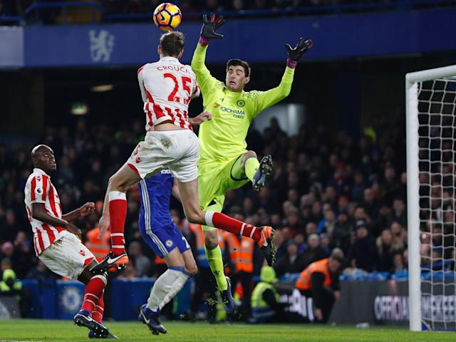 Crouch and Courtois will again go head to head when Stoke entertain Chelsea: Getty