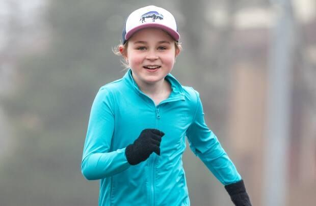 Carly Greene ran five kilometres to raise $1,600 for The Gathering Place in St. John's over the Easter Break.  (Submitted by Greg Greening - image credit)