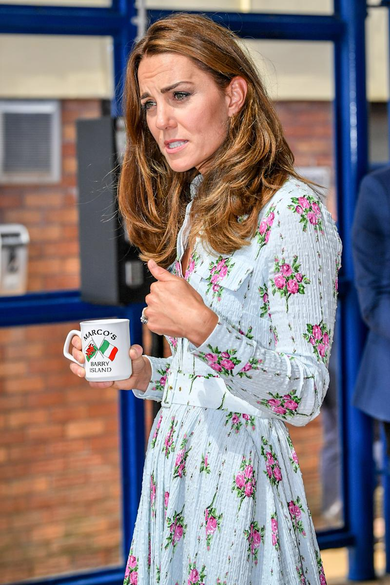 The Duchess of Cambridge holds a Marco's Cafe mug while chatting with business owners inside Marco's cafe, during the Duke and Duchess of Cambridge's visit to Barry Island, South Wales, to speak to local business owners about the impact of COVID-19 on the tourism sector.