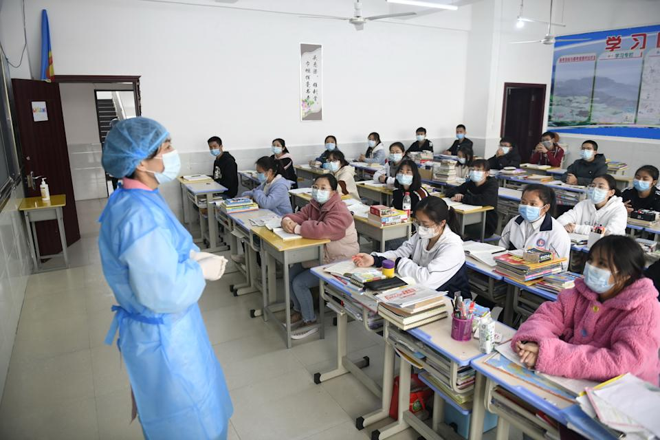 Medical staff explain protection knowledge for coronavirus and COVID-19 disease to students in China. Source: AAP