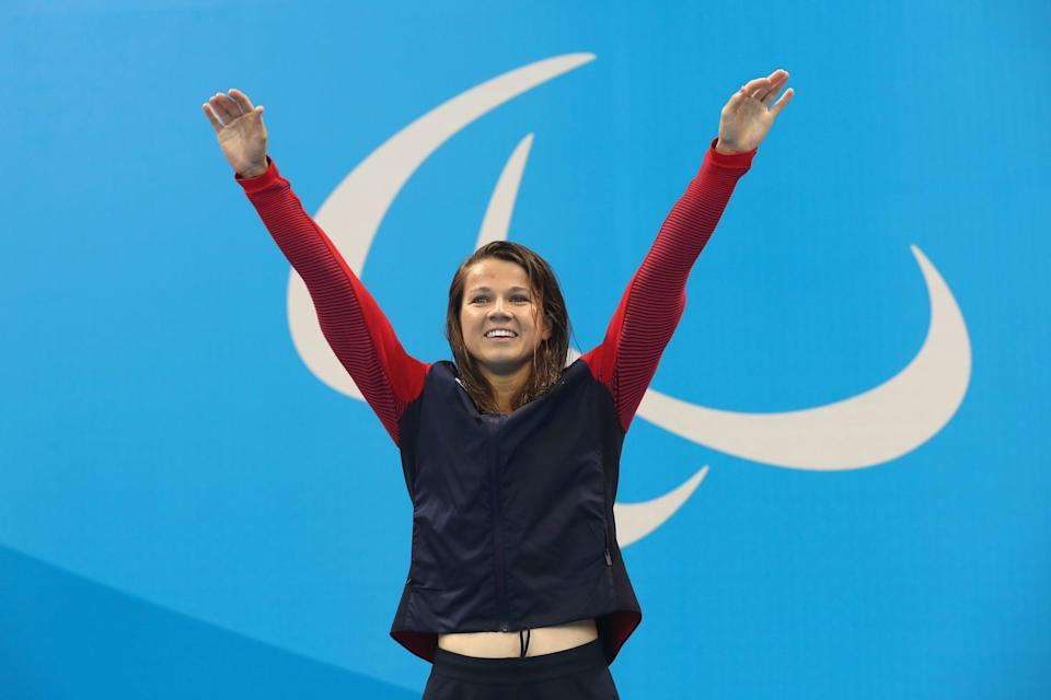 RIO DE JANEIRO, BRAZIL - SEPTEMBER 10:  Gold medalist Rebecca Meyers of the United States celebrates on the podium at the medal ceremony for the Women's 200m Individual Medley - SM13 Final on day 3 of the Rio 2016 Paralympic Games at the Olympic Aquatics Stadium on September 10, 2016 in Rio de Janeiro, Brazil.  (Photo by Buda Mendes/Getty Images)