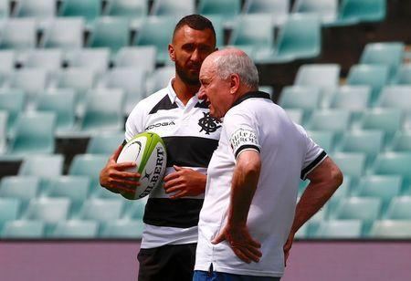 Rugby Union - Australia Wallabies vs Barbarians - Sydney Football Stadium, Sydney, Australia, October 28, 2017. Quade Cooper of the Barbarians talks with the team's head coach Alan Jones. REUTERS/David Gray