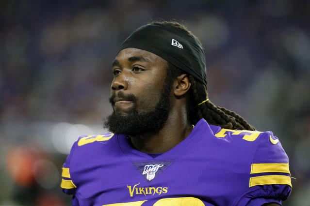 FILE - In this Oct. 24 2019, file photo, Minnesota Vikings running back Dalvin Cook walks on the field before an NFL football game against the Washington Redskins in Minneapolis. The Vikings have centered their offense around running back Dalvin Cook and praised him at every turn, but now the bill has come due. Cook is holding out of team activities until he has a new contract. (AP Photo/Bruce Kluckhohn, FIle)